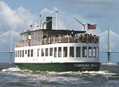 The Carolina Belle cruises along the Charleston Harbor  while on tour.