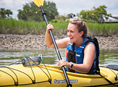 A kayaker enjoys a guided tour with Coastal Expeditions on Shem Creek.