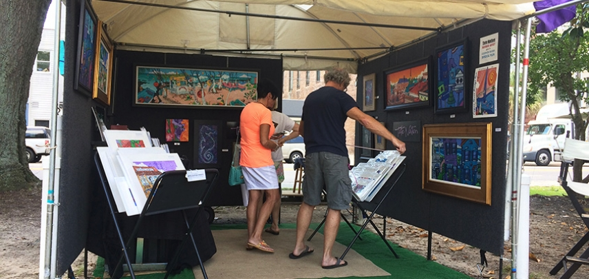 Art patrons take in artist, Tate Nation's, work in Marion Square