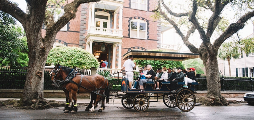 Carriage tour guests learn about the Calhoun mansion on a residential tour of the historic district.